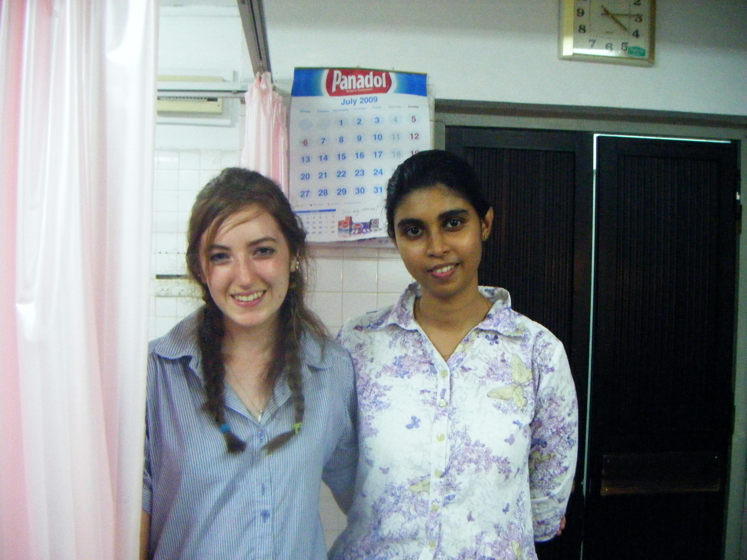 Female Dentistry intern poses with a Healthcare staff member in Hospital during a Dentistry internship placement in Sri Lanka.